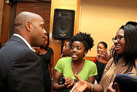 Chris Cathcart greets college students after presentation