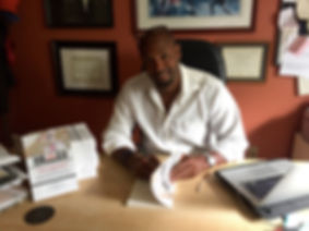 Chris signing books at desk.jpg