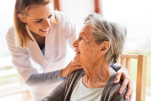 Health visitor and a senior woman during home visit..jpg
