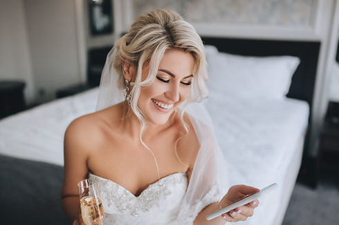 A beautiful, smiling blonde bride in a w