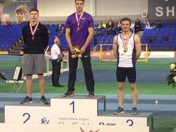 Tobi Harries winning the indoors U23 200m ina PB