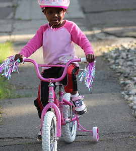 Riding a bikewith training wheels, Bike riding physiotherapy, learn to ride a bike, Melbourne, NDIS, Splash Physiotherapy