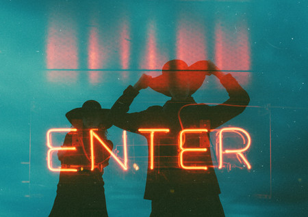 a-neon-signage-with-two-person-behind-29