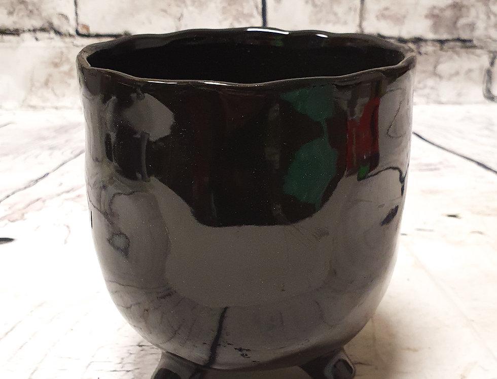 Black ceramic pot with legs