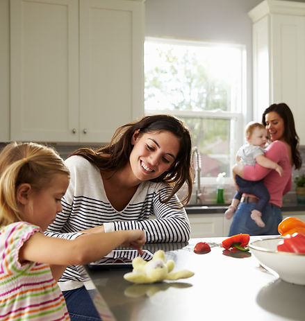 Mothers and children in kitchen