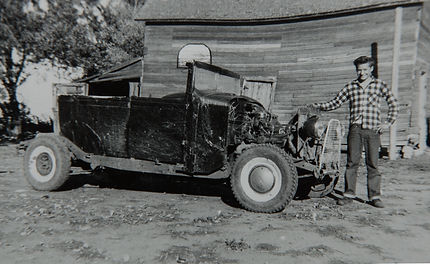 Perry Sr with first car.jpg