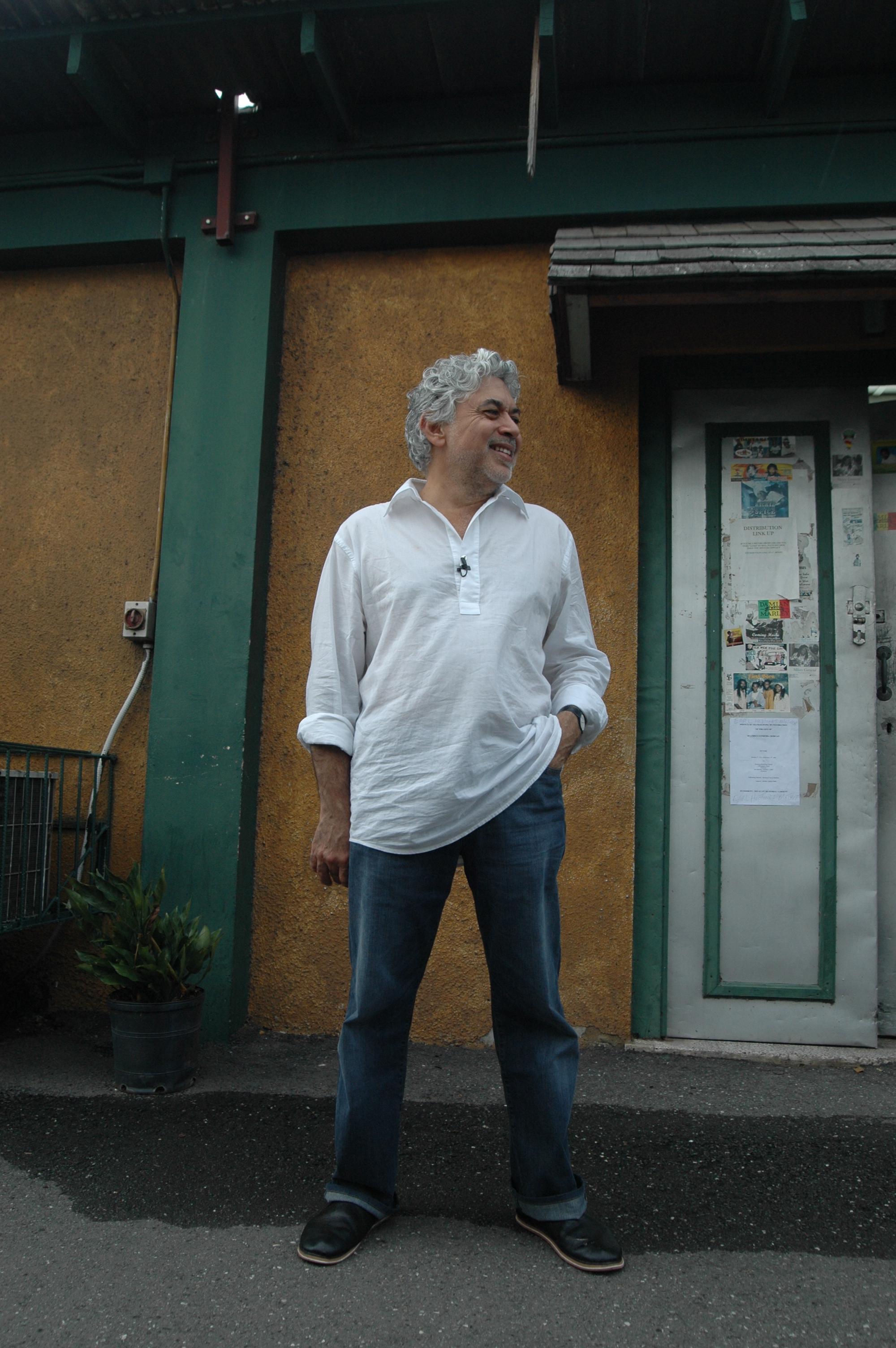 Standing at Tuff Gong door