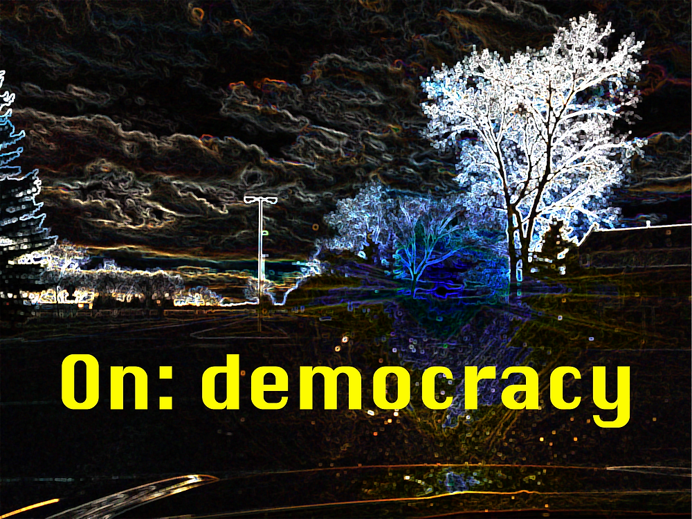 """A dark city landscape with trees, inverted colours make it a bit spoopy. Text across the image is yellow and reads """"ON: democracy"""""""