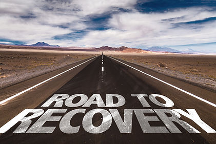 Road to Recovery written on desert road.