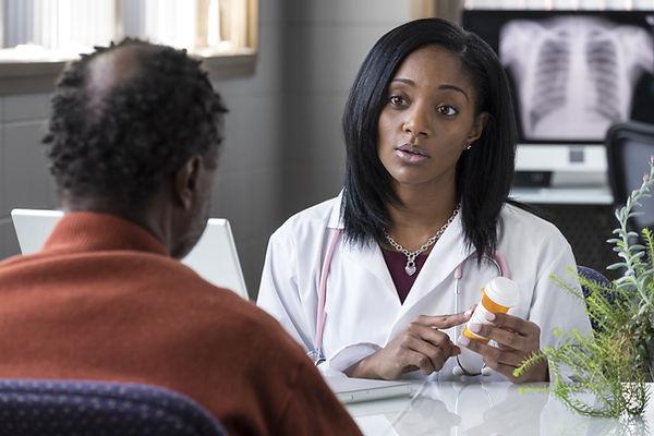 A black female physician prescribing pil