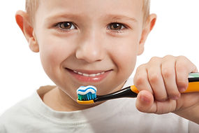 Little child with dental toothbrush brus