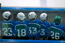 Children waiting of time to play hockey.