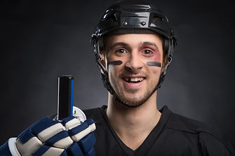 Funny hockey player smiling with one too