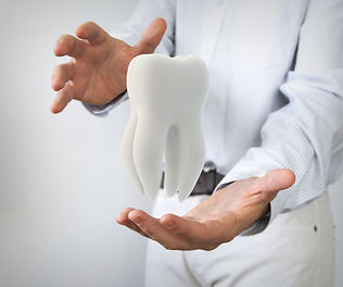 dental care concept_ molar tooth in man