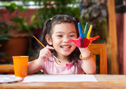 Funny little girl with painted hands