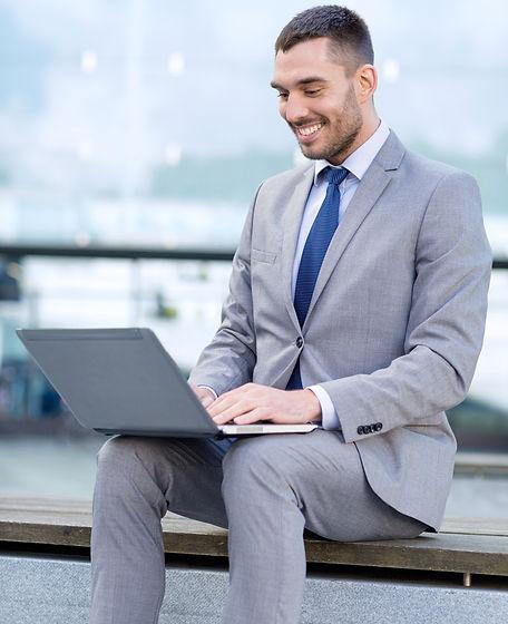 Businessman%20on%20Laptop_edited.jpg