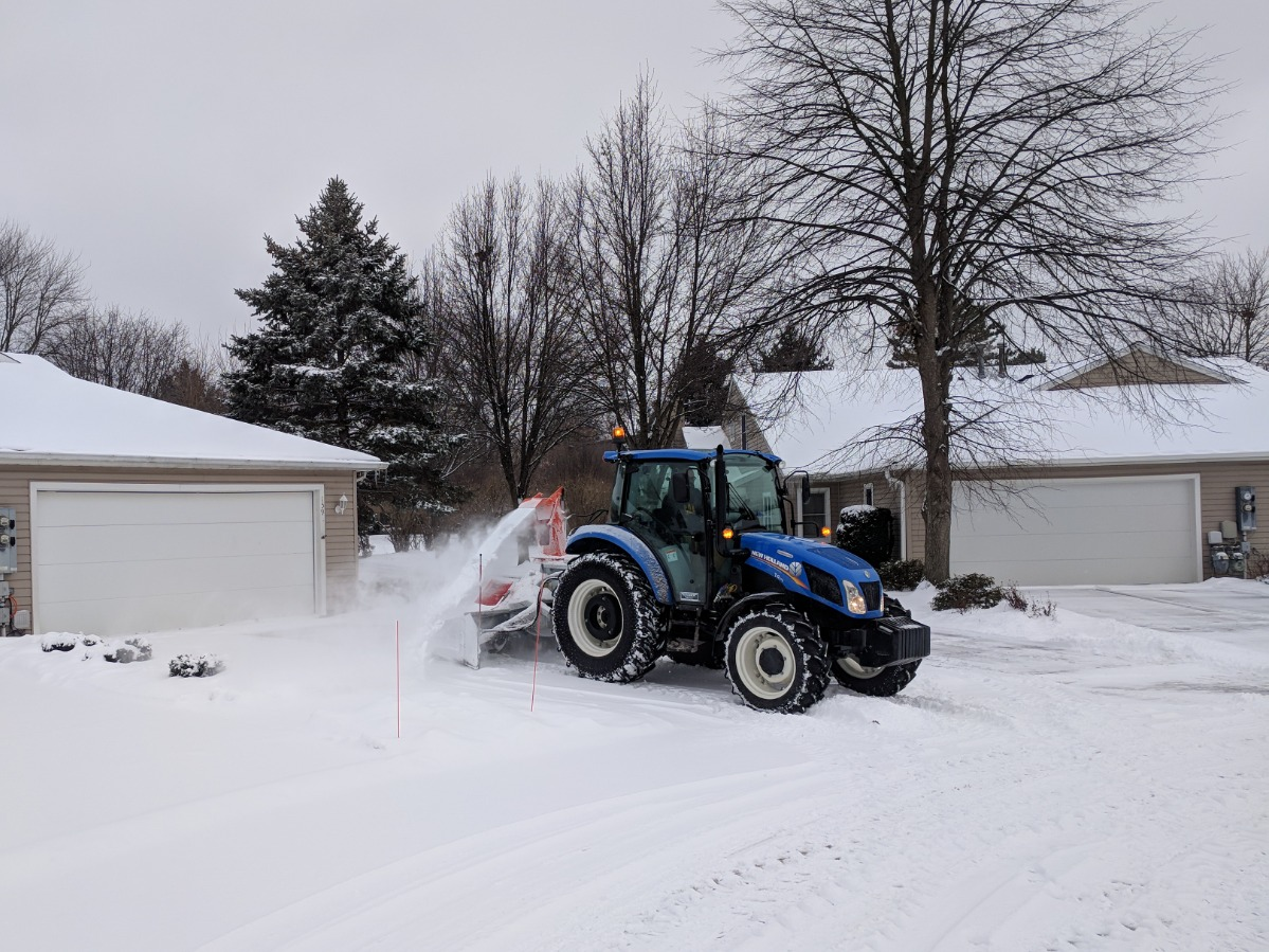 Tractor Snow Blowing