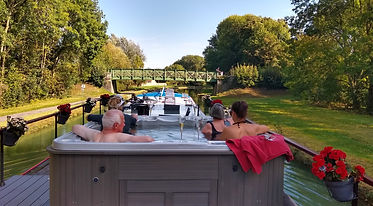 Guests in the jacuzzi on Serenity Barge