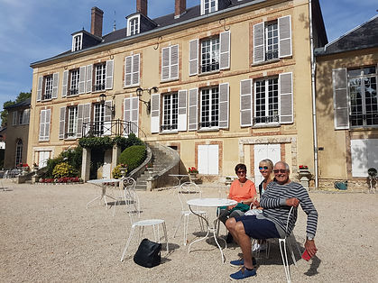 Barge cruise guests enjoying champagne at a private chateau