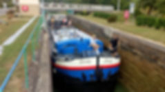 Serenity Barge squeezes into a lock on the Aisne a la Marne Canal