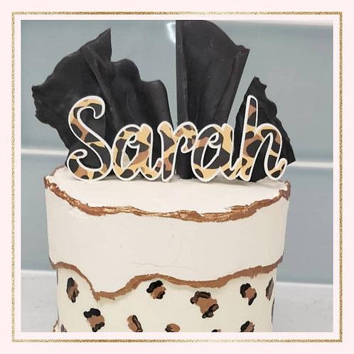 Themed 'NAME' cake topper