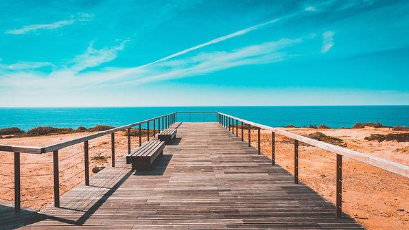 beach-bench-boardwalk-clouds-462024.jpg
