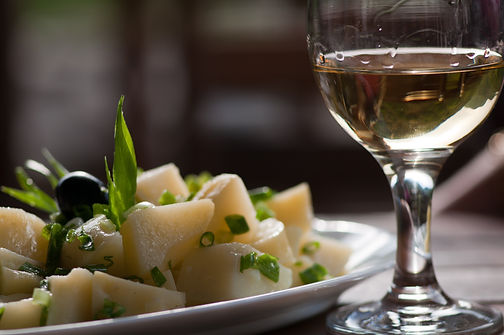 glass-of-wine-near-steamed-sliced-potato