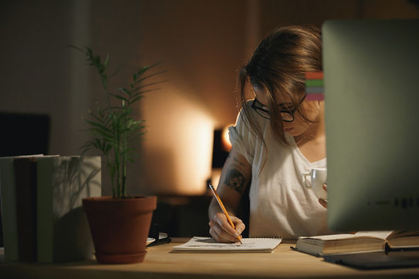 concentrated-young-woman-designer-writin