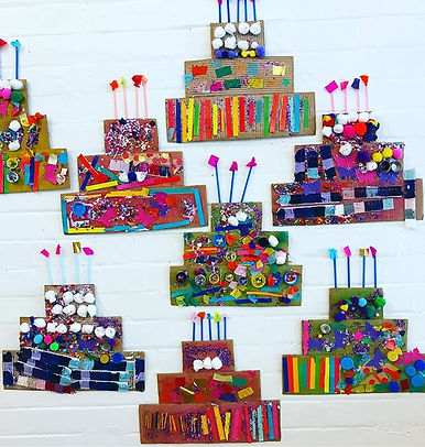 Cardboard birthday cakes made by 3-5 yea