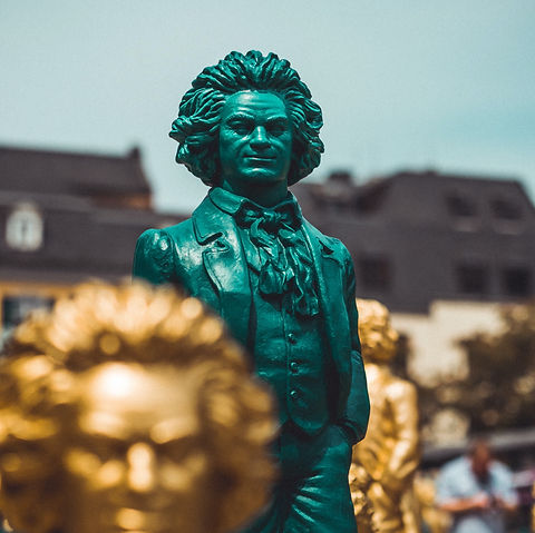 assorted-color Mozart statues_edited.jpg