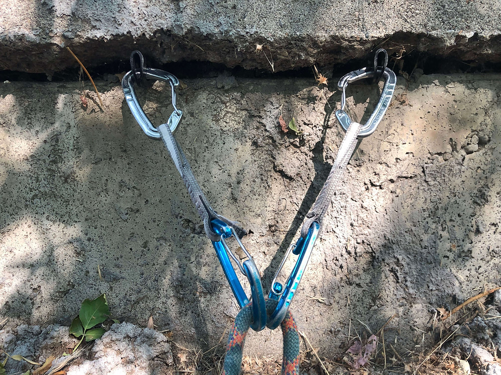 Sport climbing anchor with two quickdraws