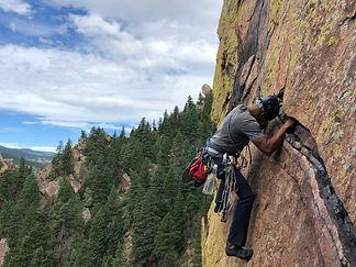 The exciting traverse on Rewritten, an Eldorado Canyon classic climb