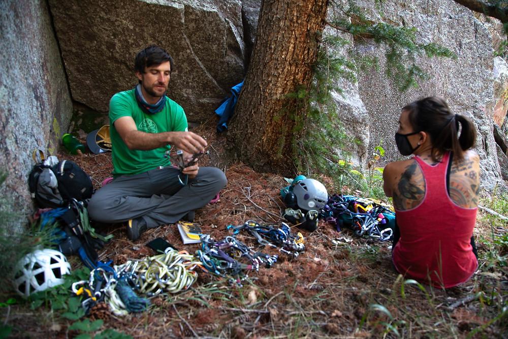 An AMGA Certified Rock Guide teaching trad climbing