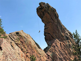 The exhilarating free-hanging rappel off the Maiden