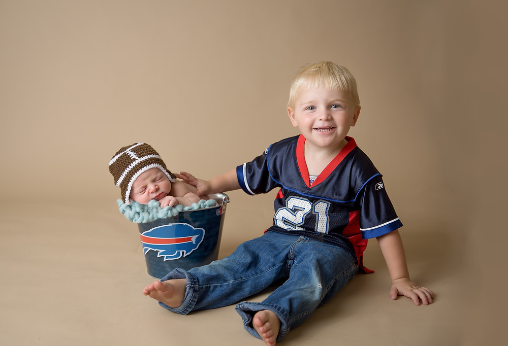 Baby in bucket with Big Brother