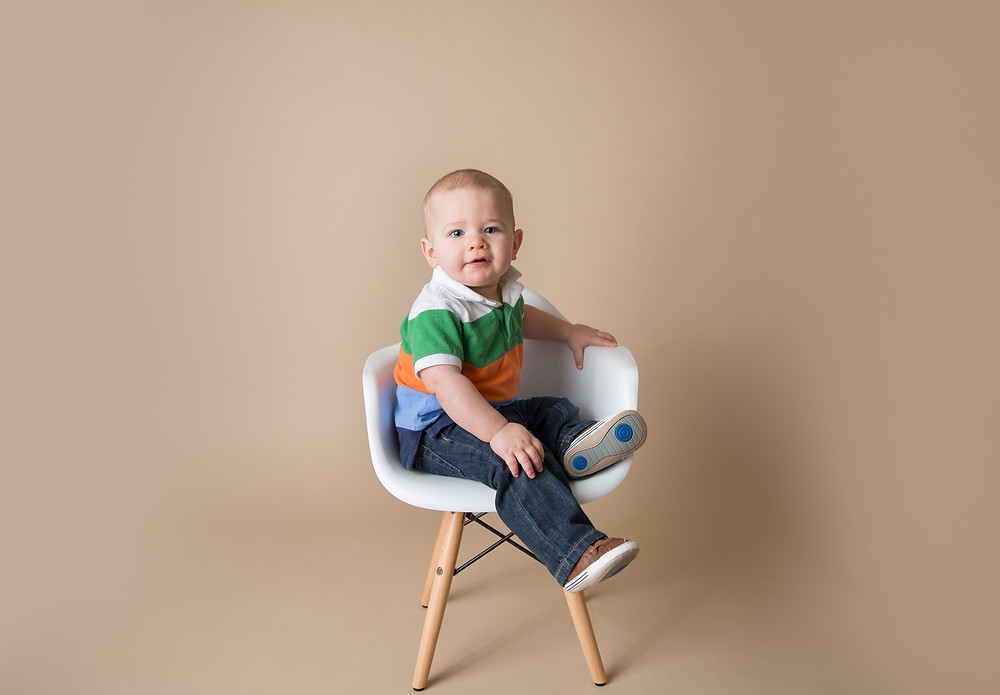 Fisher turns one; sitting in a big boy chair