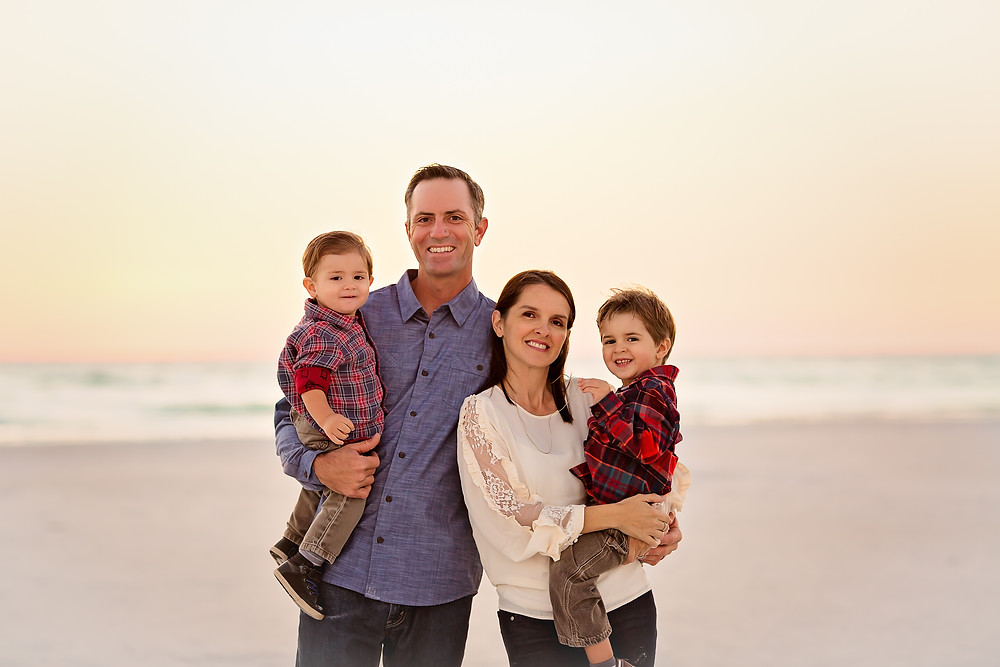 Family of four on beach in Siesta Key during sunset
