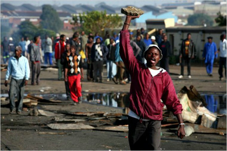 Photo: Man holding a rock during 2015 Xenophobic violence by Joao Silva