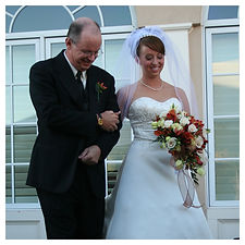father of bride and bride at wedding