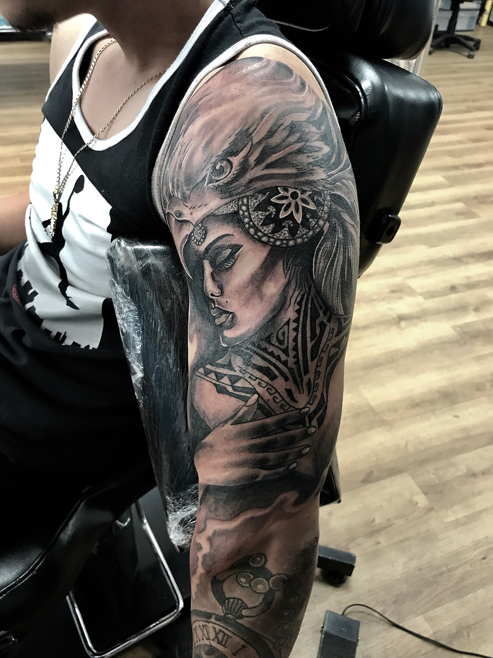 black and grey arm tattoo