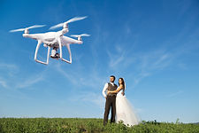Hovering drone taking pictures of weddin