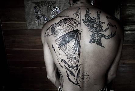 Best Blackwork bird tattoo with fine line pattern at Baan Khagee Tattoo Chiang Mai, Thailand