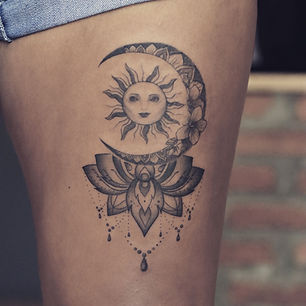 Best fine line moon and sun tattoo with lotus at Baan Khagee Tattoo Chiang Mai