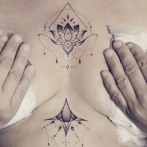 Best ornamental fine line Thai lotus tattoo by a tattoo artist in Chiang Mai, Thailand