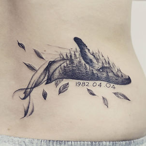 Best ethereal blackwork whale tattoo with forest at Baan Khagee Tattoo Chiang Mai
