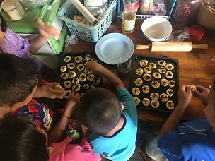 The kids make cookie