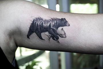 Best Blackwork bear tattoo with abstract flow at Baan Khagee Tattoo Chiang Mai, Thailand