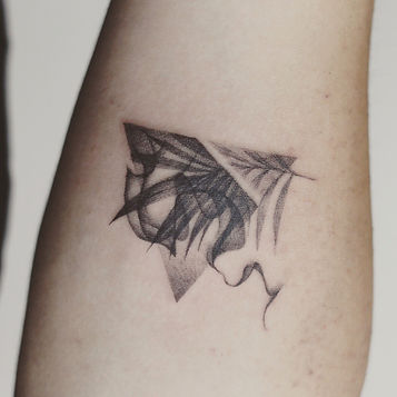 Best minimal triangle and leaves tattoo at Baan Khagee Tattoo Chiang Mai