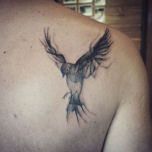 Best abstract blackwork bird tattoo at Baan Khagee Tattoo Chiang Mai