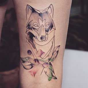 Best fine line wolf tattoo with watercolor at Baan Khagee Tattoo Chiang Mai